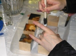 Gluing the photos onto the blocks with Mod Podge.