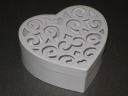 The cute little filigree-lidded heart boxes we used for candy boxes.  I still have about 30 left if anyone want to buy them from me!
